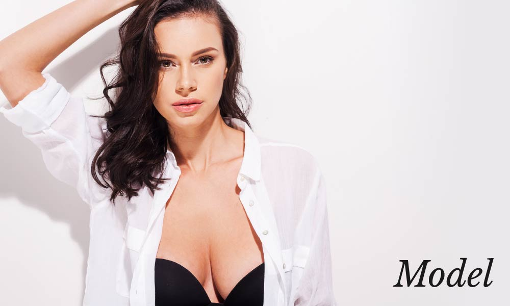 Model With White Unbuttoned Blouse Over Black Bra
